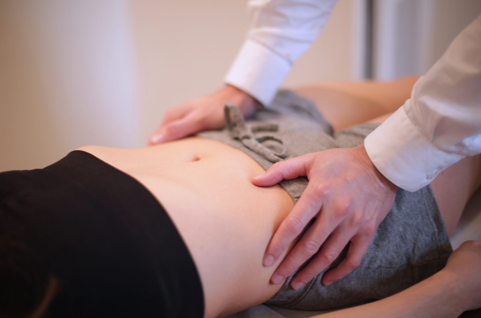Physiotherapist massaging patient